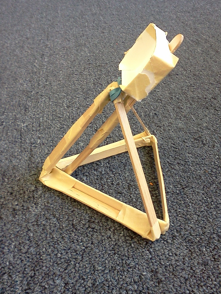 picture of a catapult made with popsicle sticks and tape